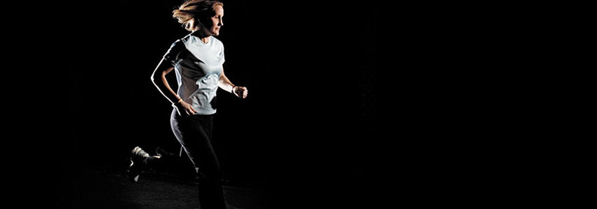 The woman running with black background